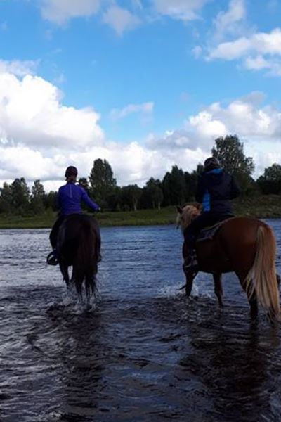 Trail riding in the river
